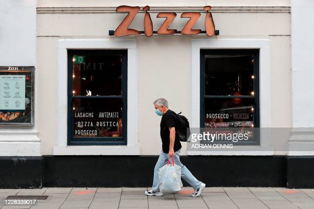 A pedestrian pass a branch of the chain Italian restaurant Zizzi in Salisbury southern England on September 4 2020 that was cordoned off following...
