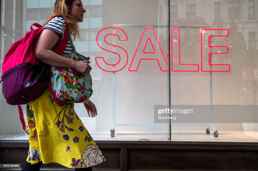 A pedestrian pass a sale sign in the window of a Hennes & Mauritz AB (H&M) retail store on Oxford Street, in central London, U.K., on Wednesday, June 13, 2018. U.K. department-store chain House of Fraser said it plans to shut more than half its outlets, putting 6,000 jobs at risk. Photographer: Chris J. Ratcliffe/Bloomberg via Getty Images