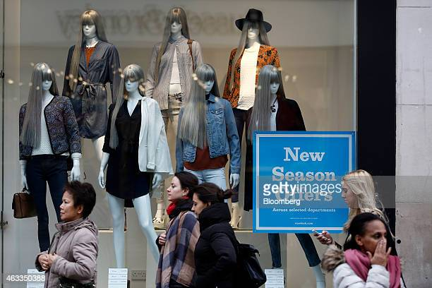 Pedestrian pass mannequins as they display clothes in the window of a New Look fashion store operated by New Look Group Ltd on Oxford Street in...