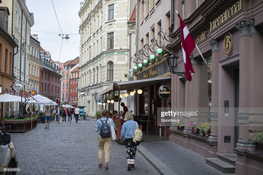 Pedestrian pass the headquarters of the Baltic International Bank AS in Riga, Latvia, on Wednesday, June 13, 2018. Latvia's plans to kick out risky cash from its scandal-plagued banks are about to accelerate. Photographer: Jasper Juinen/Bloomberg via Getty Images