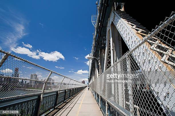 Pedestrian passageway on the Manhattan Bridge, a suspension bridge spanning the East River and connecting Lower Manhattan with Downtown Brooklyn, in New York City, USA