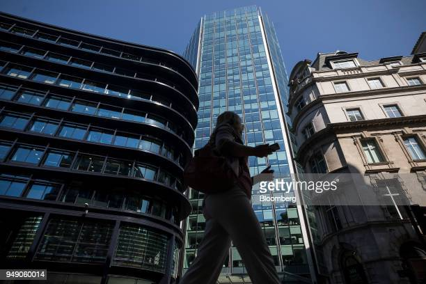 A pedestrian passes 125 Old Broad Street in the City of London UK on Friday April 20 2018 Foreign investors are less worried about the impact of...