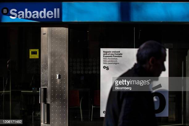 A pedestrian passes a Banco de Sabadell SA bank branch in Barcelona Spain on Saturday March 7 2020 Spanish bank shares soared after the European...