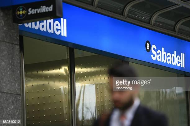 Pedestrian passes a Banco de Sabadell SA bank branch in Barcelona, Spain, on Friday, Jan. 27, 2016. Banco de Sabadell SA, the Spanish bank that owns...