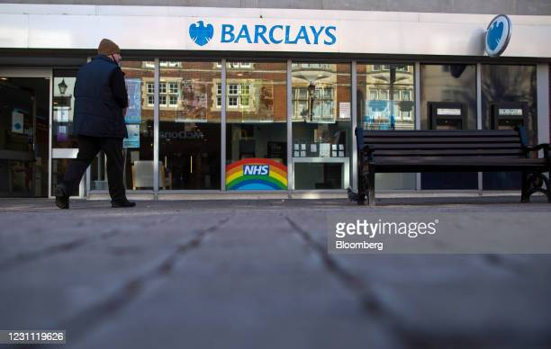 Pedestrian passes a Barclays Bank Plc bank branch in Staines, U.K., on Friday, Feb. 12, 2021. The U.K. Economy grew at double the pace expected in...