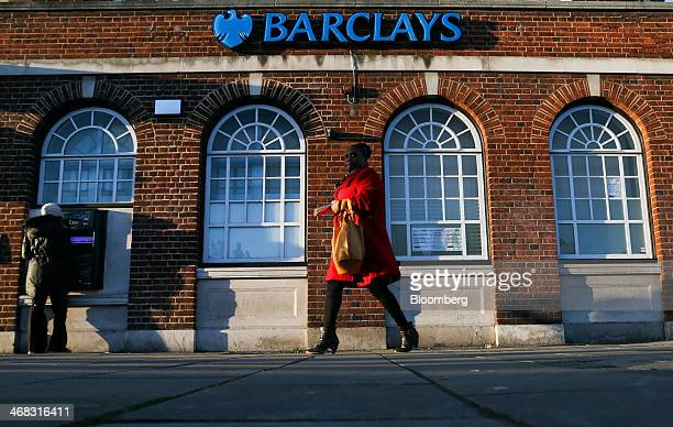 A pedestrian passes a Barclays Plc bank branch in Chadwell Heath UK on Friday Feb 7 2014 Barclays Plc reported fullyear profit that missed analyst...