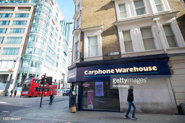 A pedestrian passes a branch of Carphone Warehouse operated by Dixons Carphone Plc in London UK on Tuesday March 17 2020 Dixons plans to close 531...