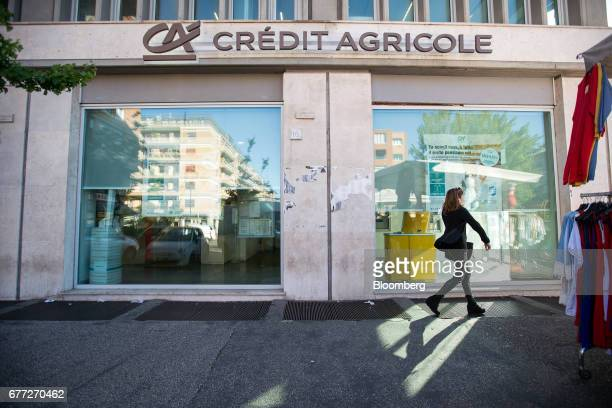 Pedestrian passes a branch of Credit Agricole SA's Cariparma bank in Rome, Italy, on Tuesday, May 2, 2017. Cariparma is in preliminary talks with the...