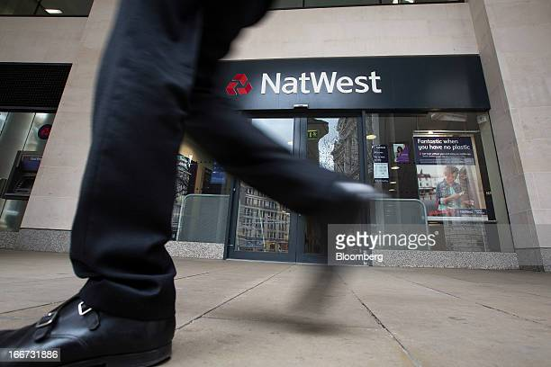 A pedestrian passes a branch of NatWest bank part of the Royal Bank of Scotland Group Plc in London UK on Tuesday April 16 2013 The UK's...