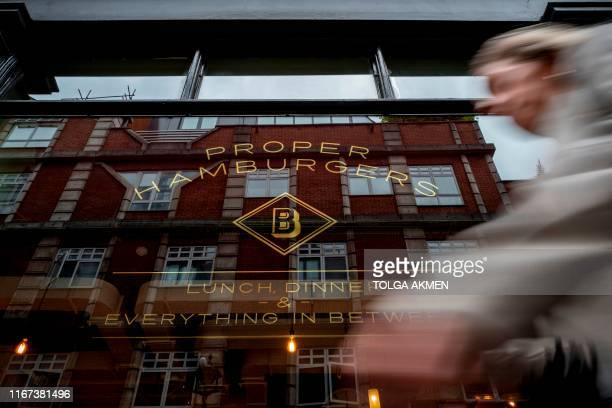 A pedestrian passes a Byron hamburgers restaurant in central London on September 11 2019