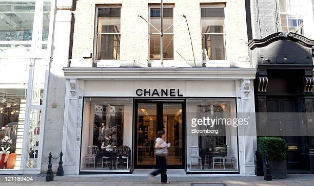 Pedestrian passes a Chanel SA fashion store on Old Bond Street in central London, U.K., on Monday, Aug. 15, 2011. U.K. Inflation probably accelerated...