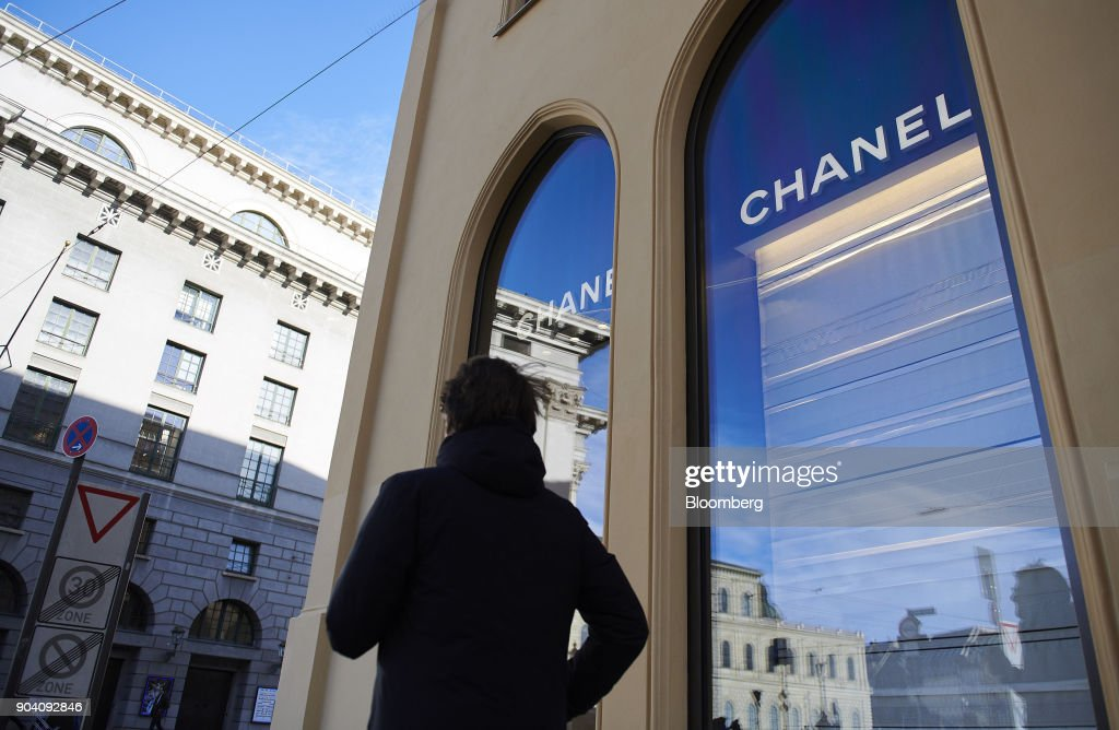 A pedestrian passes a Chanel SA luxury goods store in Munich, Germany, on Tuesday, Jan. 9, 2018. The German economy's solid 2017 performance extended into the final three months of the year, with growth of about half a percent. Photographer: Dominik Osswald/Bloomberg via Getty Images