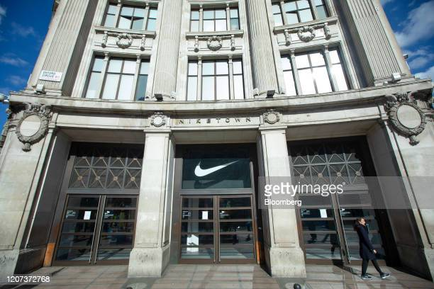 A pedestrian passes a closed Nike Inc NikeTown store in London UK on Monday March 16 2020 Retail has become a bellwether of the coronavirus crisis as...