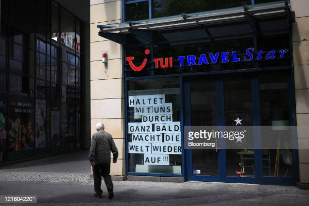 Pedestrian passes a closed TUI AG Travel Star travel agents in Magdeburg, Germany, on Thursday, May 28, 2020.German ChancellorAngela Merkels...