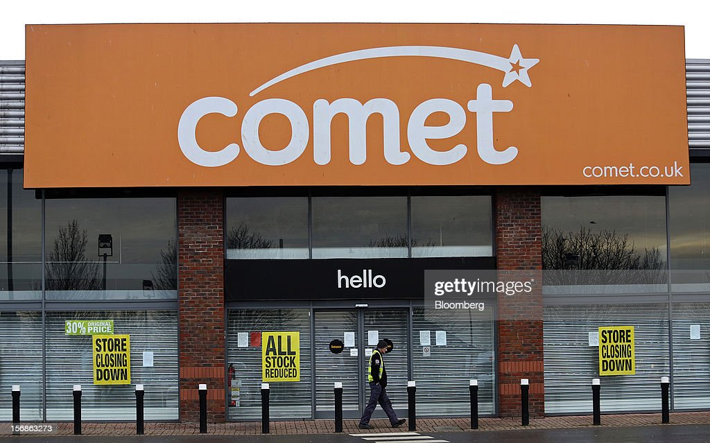 A pedestrian passes a Comet electronics store displaying 'Store Closing Down' signs in the window display, in Slough, U.K., on Friday, Nov. 23, 2012. Comet, a U.K. electronics chain, appointed Deloitte LLP as insolvency administrator, less than a year after being bought by private-equity firm OpCapita LLP. Photographer: Chris Ratcliffe/Bloomberg via Getty Images
