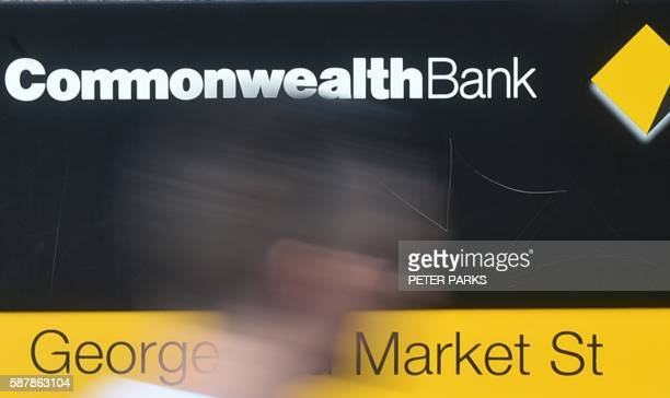 A pedestrian passes a Commonwealth Bank branch in Sydney on August 10 2016 Australia's biggest bank the Commonwealth sounded a cautious note about...