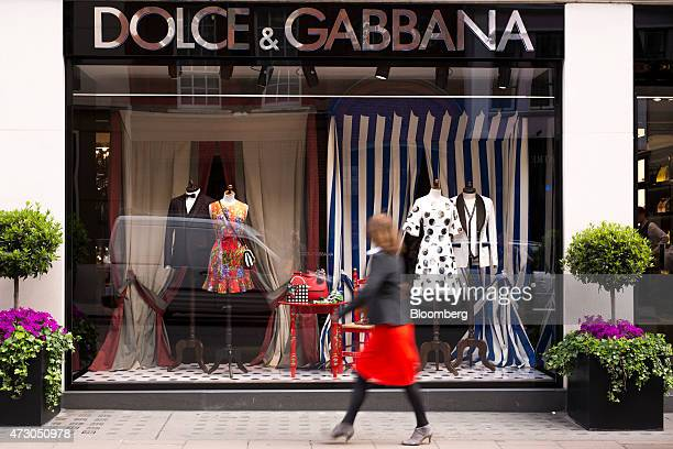 A pedestrian passes a Dolce Gabbana Srl clothing fashion store on New Bond Street in London UK on Tuesday May 12 2015 The euroarea economy probably...