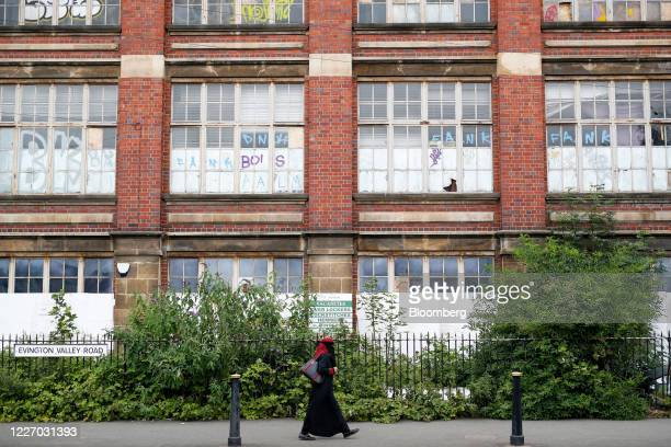 A pedestrian passes a former textile business in Leicester UK on Monday July 13 2020 Leicester has been a hub for manufacturing in Britain since the...