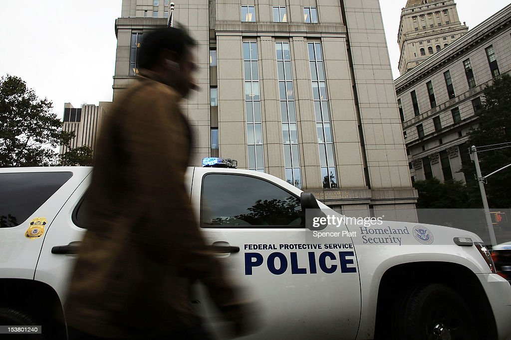 A pedestrian passes a Homeland Security vehicle outside of U.S. District Court in Manhattan during a court appearance for three men brought from England to New York to face terrorism charges on October 9, 2012 in New York City. Security was heightened during a hearing for Khaled al-Fawwaz, Adel Abdul Bary and Abu Hamza al-Masri to learn how their cases will proceed to trial. Al-Masri, the one armed Egyptian-born preacher, faces charges that he attempted to set up a terrorist training camp in Oregon and assisted in the abduction of 16 hostages, two of them American tourists, in Yemen in 1998. Both al-Fawwaz and Abdul Bary face charges that they participated in the bombings of embassies in Tanzania and Kenya in August 1998.