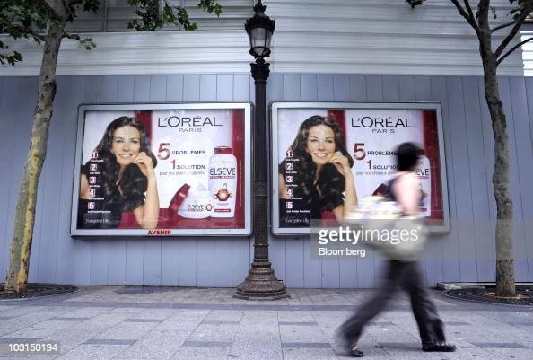 A pedestrian passes a JCDecaux SA Avenir advertising ...