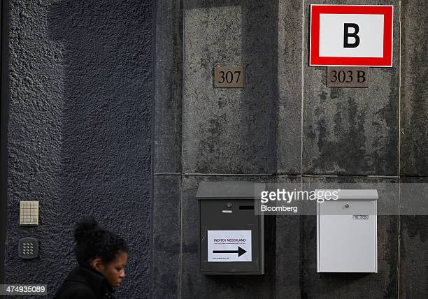 A pedestrian passes a mail box marked Inditex Nederland center as it sits outside the offices of ITX Merken BV a subsidiary of clothing fashion...