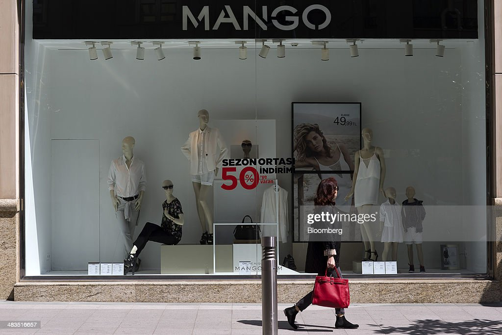 A pedestrian passes a Mango fashion store advertising half price discounts in Istanbul, Turkey, on Wednesday, April 9, 2014. Turkish central bank Governor Erdem Basci indicated to analysts in London on April 3 that he planned to keep monetary policy tight to control inflation. Photographer: Kerim Okten/Bloomberg via Getty Images