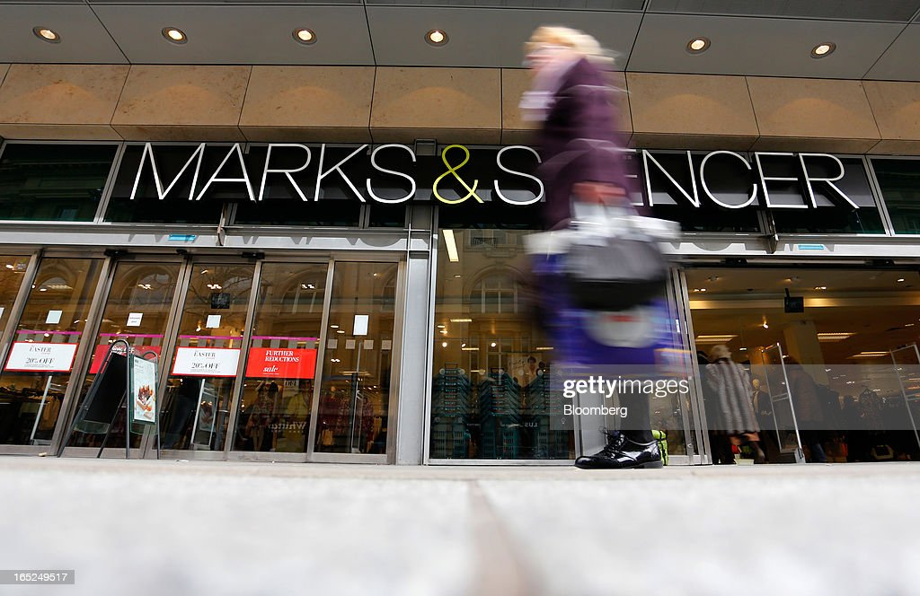 A pedestrian passes a Marks & Spencer Group Plc (M&S) store in Manchester, U.K., on Monday, April 1, 2013. U.K. retail sales unexpectedly stagnated in March in a sign that consumer spending remains under pressure from higher energy bills and weak wage growth. Photographer: Paul Thomas/Bloomberg via Getty Images