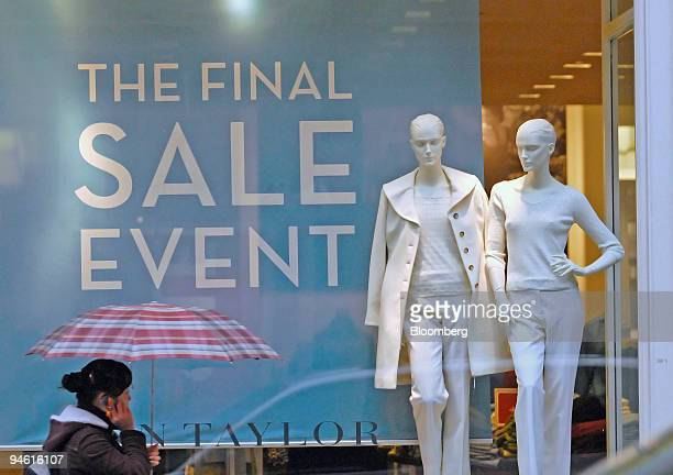 A pedestrian passes a sale sign in the window of an Ann Taylor store New York US on Thursday Dec 27 2007 Spending surges after the Thanksgiving...