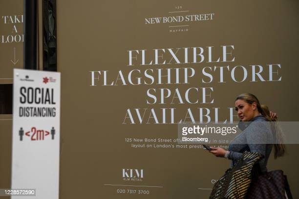 Pedestrian passes a sign advertising an empty available shop on New Bond Street in central London, U.K., on Thursday, Sep. 17, 2020. U.K. Retail...
