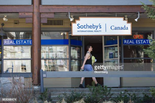 A pedestrian passes a Sotheby's International Realty store in Whistler British Columbia Canada on Friday April 27 2018 The cost of a typical home in...