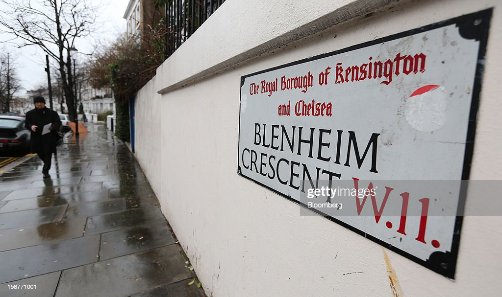 A pedestrian passes a street sign on Blenheim Crescent in the Kensington and Chelsea borough of London, U.K., on Friday, Dec. 28, 2012. Egerton Crescent, close to Harrods luxury department store in Knightsbridge, is the most expensive address in the borough, with an average property value of 8.14 million pounds ($13.2 million), Lloyds TSB said. Photographer: Chris Ratcliffe/Bloomberg via Getty Images