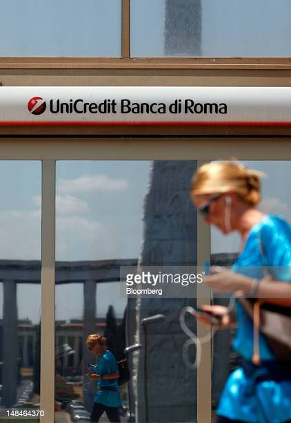 Pedestrian passes a UniCredit SpA bank branch in Rome, Italy, on Tuesday, July 17, 2012. UniCredit SpA and Intesa Sanpaolo SpA were among 13 Italian...