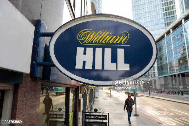 A pedestrian passes a William Hill Plc betting shop in London UK on Monday Sept 28 2020 Caesars Entertainment Inc said William Hill Plcs board would...