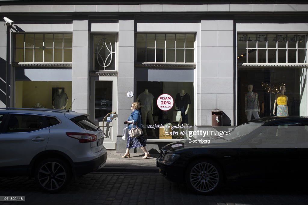 A pedestrian passes a women's clothing fashion store offering discounts in Riga, Latvia, on Thursday, June 14, 2018. Latvia's plans to kick out risky cash from its scandal-plagued banks are about to accelerate. Photographer: Jasper Juinen/Bloomberg via Getty Images