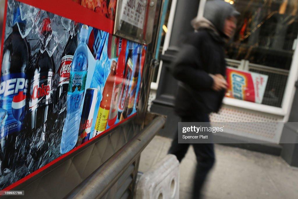 A pedestrian passes an advertisment for soda on January 23, 2013 in New York City. As American consumers continue to shift to water, coffee, and other drinks, soda sales have fallen in the U.S. Soda sales in volume dropped 1.8% last year to $28.70 billion. In New York Mayor Michael Bloomberg has a launched a campaign and passed a ban on extra large-size sodas, which his administration has linked to diabetes and obesity.