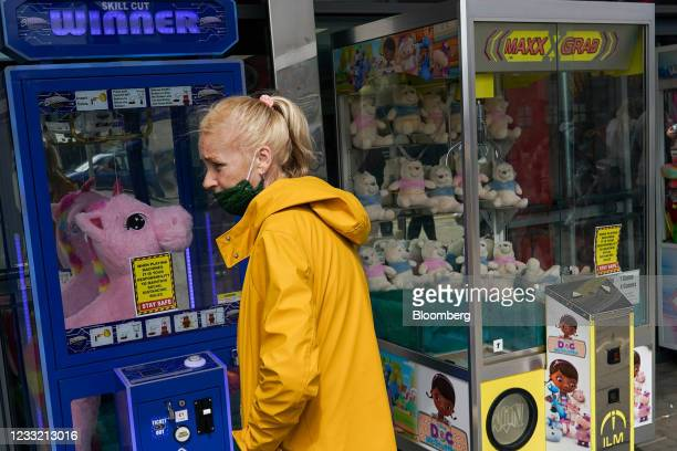 Pedestrian passes an amusement arcade in Skegness, U.K., on Monday, May 31, 2021. U.K. Health Secretary Matt Hancock said people who want to go on...