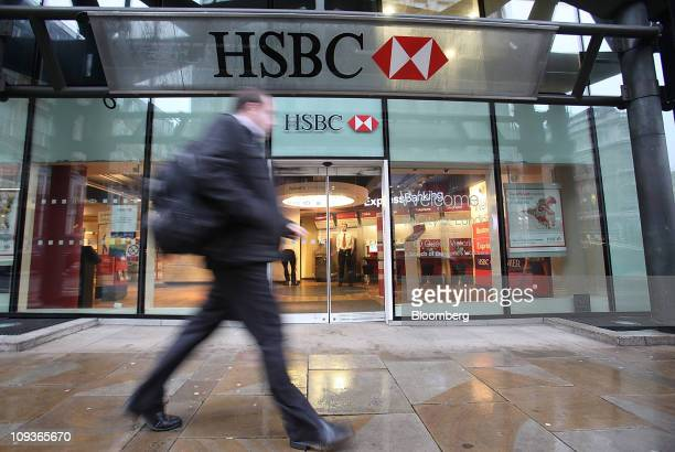 A pedestrian passes an HSBC Holdings Plc bank branch in London UK on Wednesday Feb 23 2011 HSBC Holdings Plc and two other banks have agreed to...