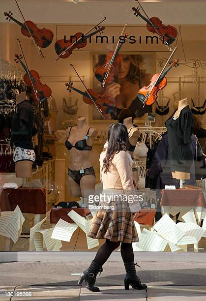 A pedestrian passes an Intimissimi lingerie store window display on King's Road in London UK on Monday Oct 24 2011 Growth in luxurygoods sales may...