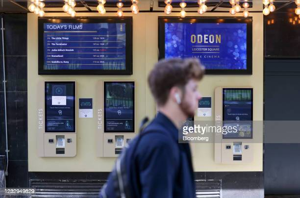 Pedestrian passes automatic ticket machines outside the Odeon cinema in Leicester Squaure in London, U.K., on Monday, May 17, 2021. England...