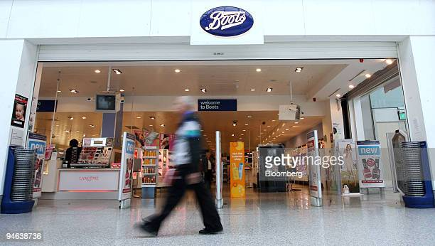 A pedestrian passes by a Boots pharmacy in Romford Essex UK on Friday April 20 2007 Guy Hands's Terra Firma Capital Partners Ltd raised its bid for...