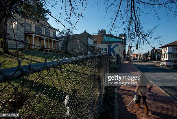 Pedestrian passes decaying homes in the 2200 block of Martin Luther King Avenue in Washington, DC on January 17, 2014. The parcel, better known as...