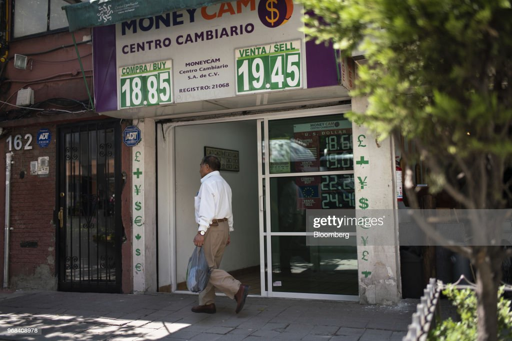Currency Exchange Locations As Mexican Peso Falls To Lowest In A Year News Photo