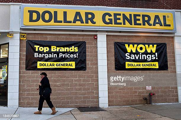 A pedestrian passes in front of a Dollar General Corp store in Roselle New Jersey US on Friday Dec 2 2011 Dollar General Corp is scheduled to annouce...
