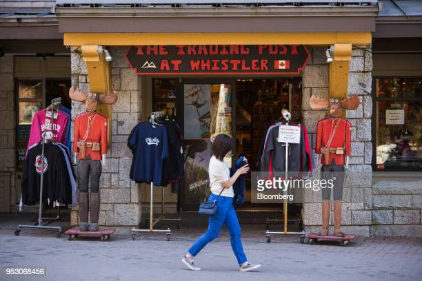 A pedestrian passes in front of a gift shop in Whistler Village in Whistler British Columbia Canada on Friday April 27 2018 The cost of a typical...