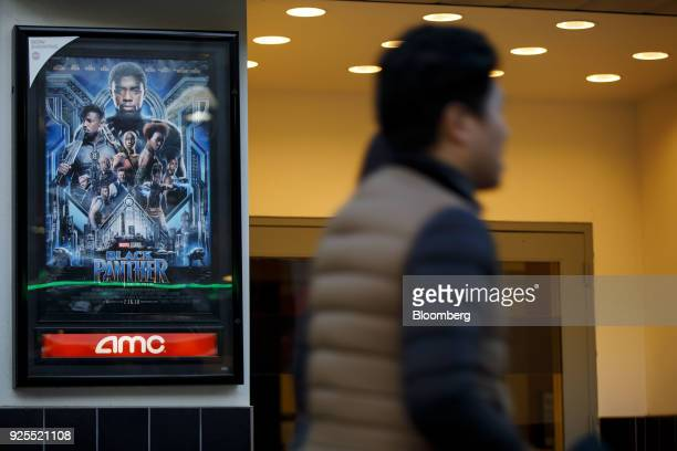 "Pedestrian passes in front of a Marvel Studios LLC ""Black Panther"" movie poster displayed outside an AMC Entertainment Inc. Theater in Santa Monica,..."