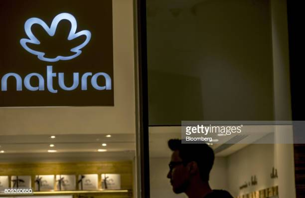 A pedestrian passes in front of a Natura Cosmeticos SA store inside the Santos Dumont Airport in Rio de Janeiro Brazil on Monday June 25 2017 British...
