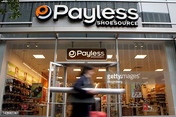 Pedestrian passes in front of a Payless ShoeSource Inc. Store in New York, U.S., on Wednesday, May 2, 2012. JPMorgan Chase & Co. And Wells Fargo &...