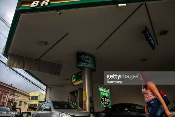 A pedestrian passes in front of a Petrobras Distribuidora SA gas station in Sao Paulo Brazil on Monday Dec 11 2017 Petroleo Brasileiro SA  is getting...