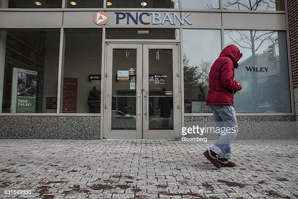 A pedestrian passes in front of a PNC Financial Services Group Inc bank branch in Hoboken New Jersey US on Monday Jan 9 2017 PNC Financial Services...