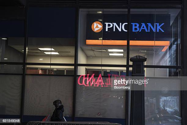 A pedestrian passes in front of a PNC Financial Services Group Inc bank branch in New York US on Monday Jan 9 2017 PNC Financial Services Group Inc...